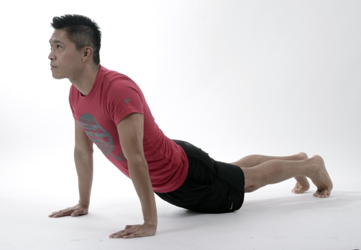 A man doing a version of the cobra pose.